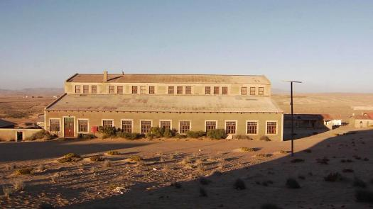 Abandoned buildings and houses in Kolmanskop, a ghost town in the Namib desert in southern Namibia